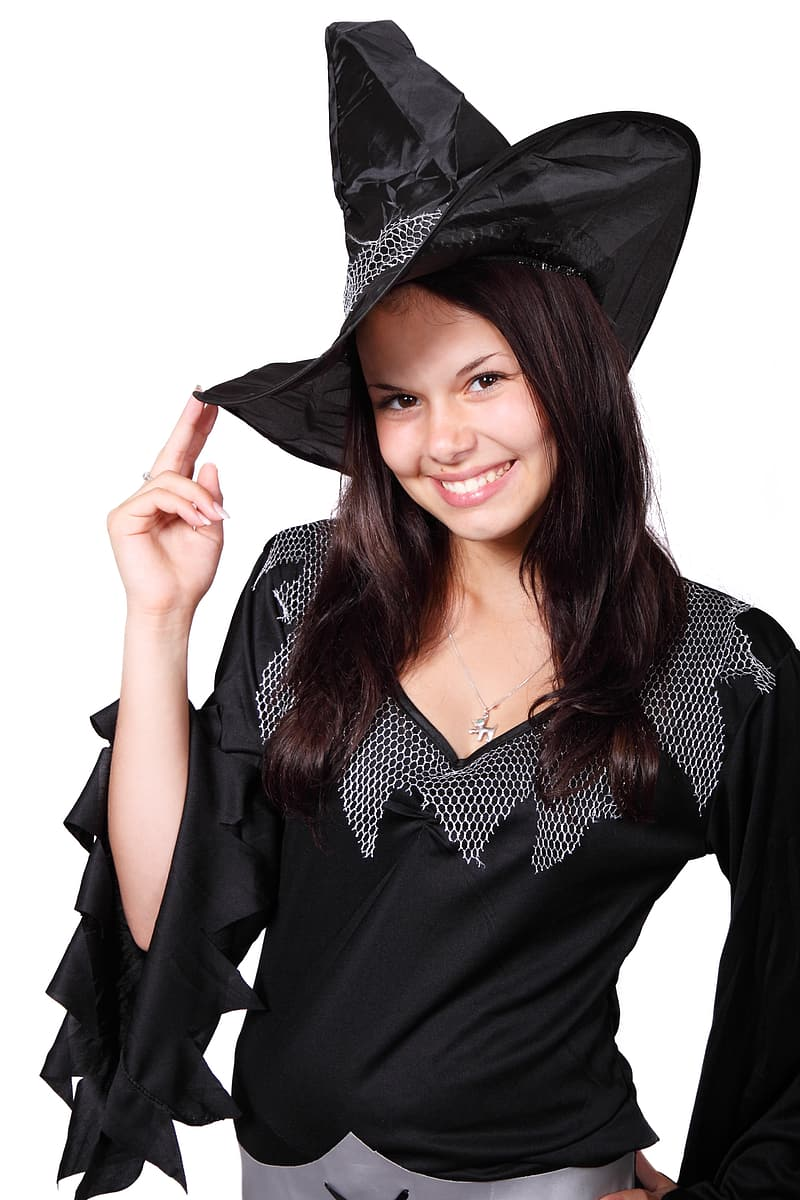 Smiling woman wearing witch hat and v-neck top