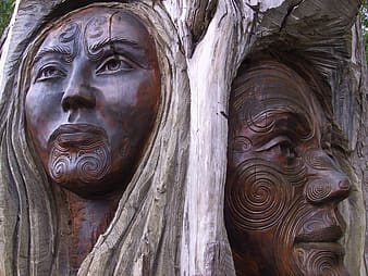 Two carving of Hawaiian people tribe