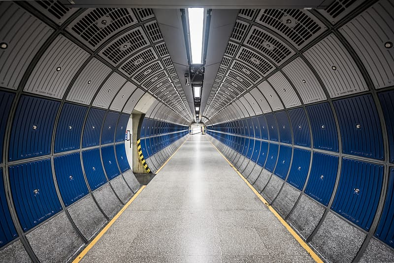 Tunnel with blue and gray metal wall