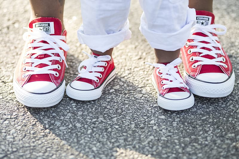 Pair of boy's and men's red-and-white Converse All-Star low-tops