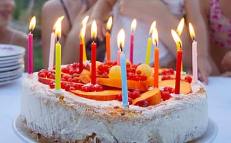 Lighted candles cake