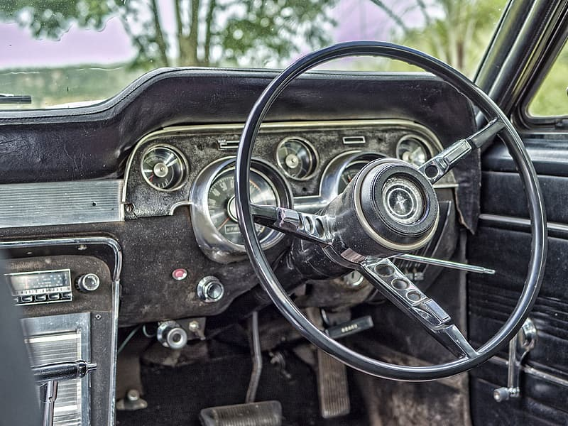 Closeup photograph of steering wheel and car radio