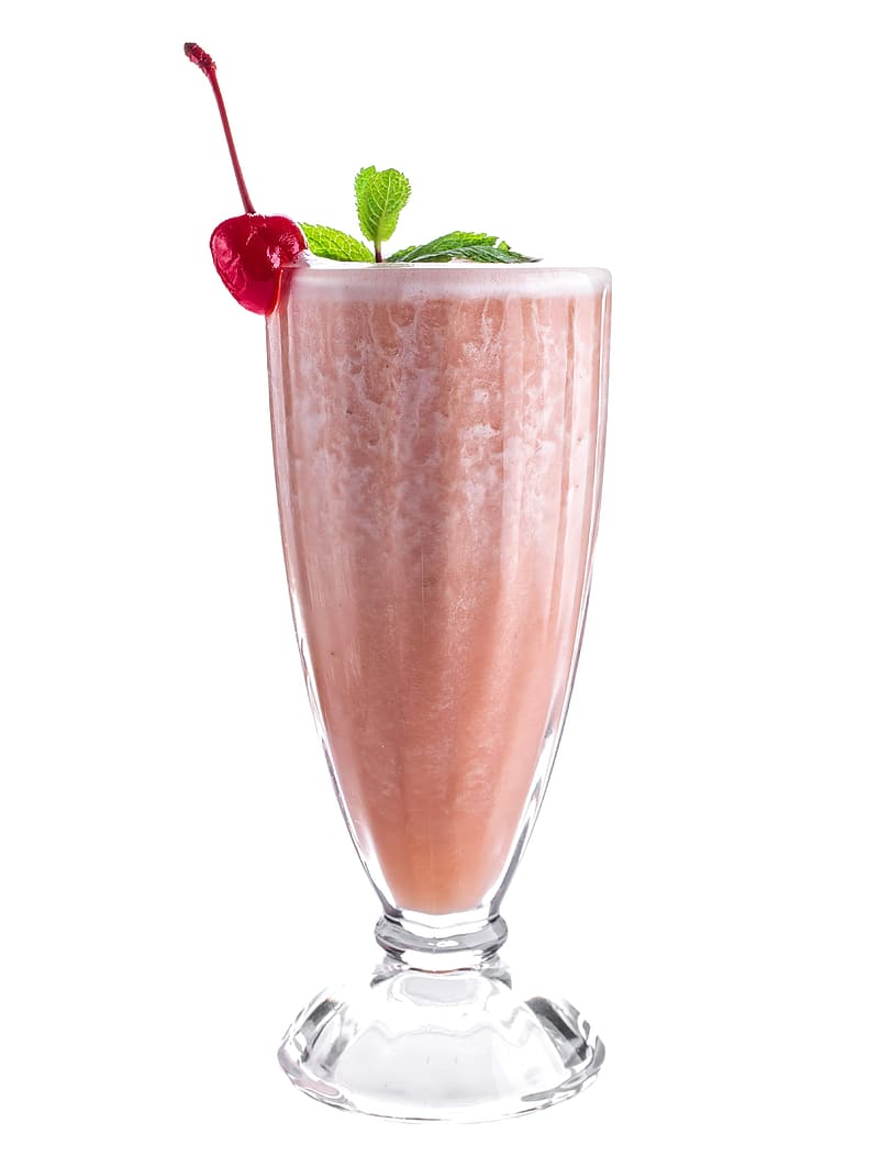 Fruit shake in clear footed cocktail glass garnished with cherry fruit and mint leaves