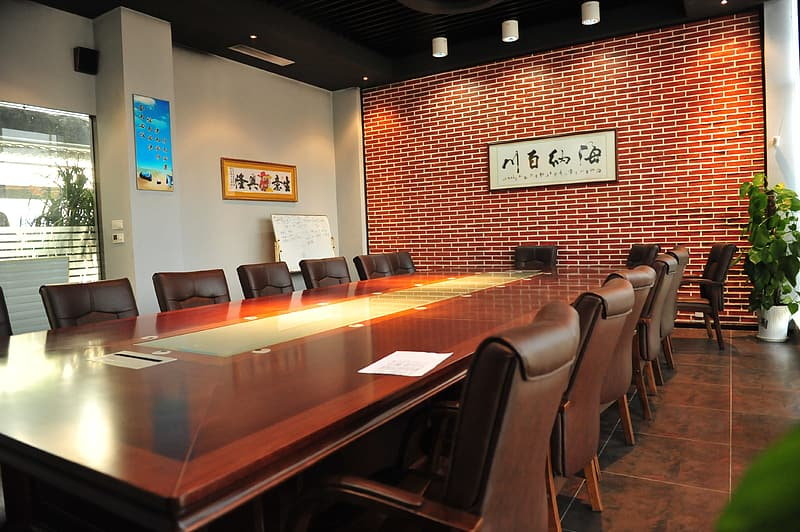 Empty brown wooden conference table