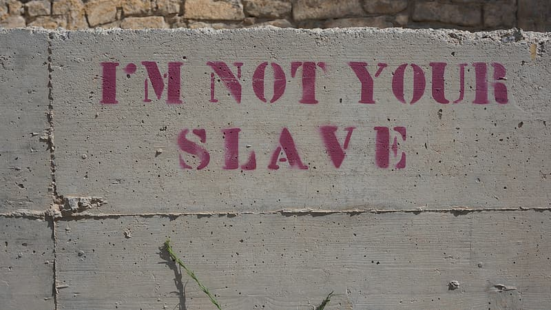 I'm Not Your Slave text on gray concrete wall