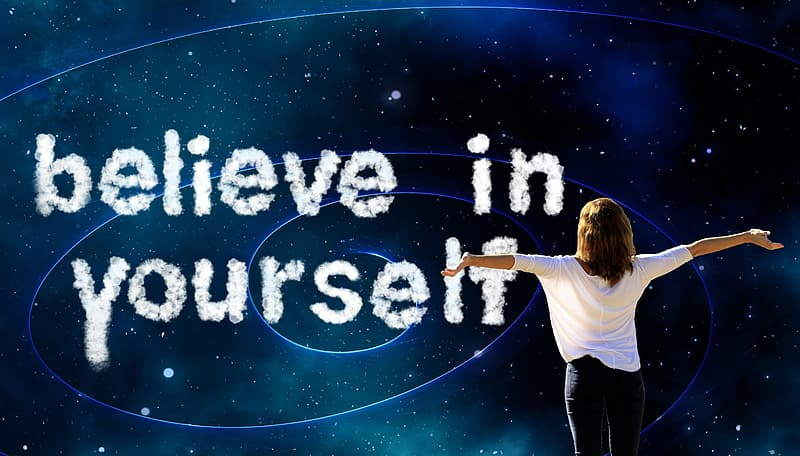 Woman in white shirt spreading arms with believe in yourself text overlay