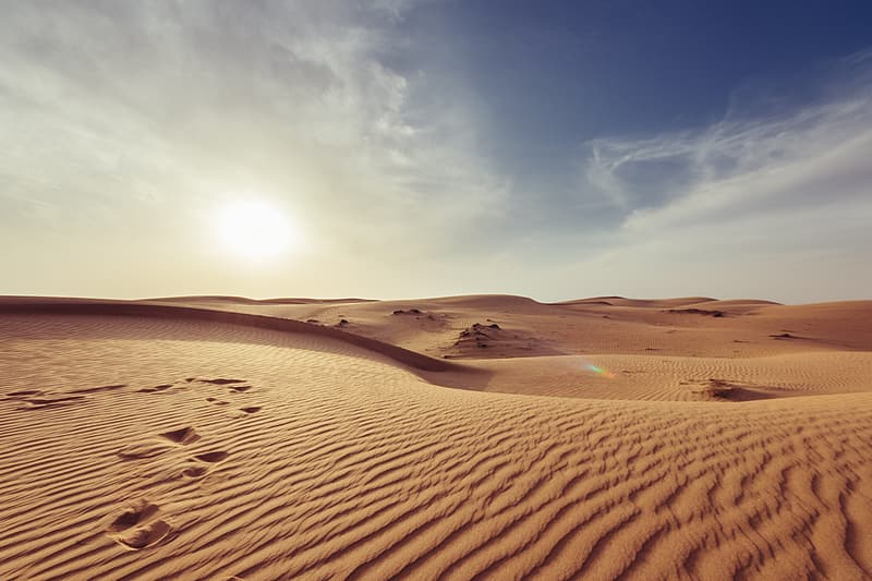 Brown sand under blue sky during daytime