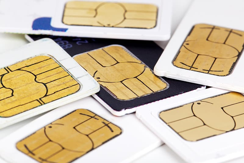 Whit and black SIM cards close-up photo