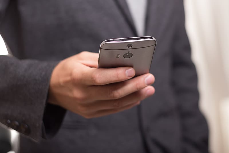 Person holding gray Android smartphone