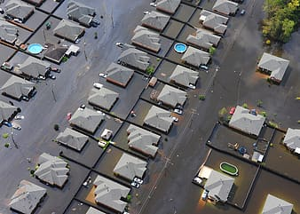 Aerial view photography of houses surrounded by water