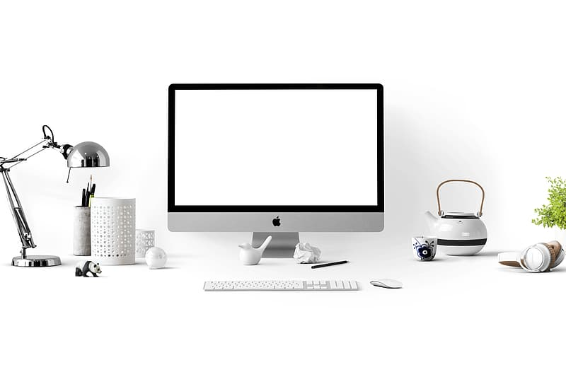 Silver iMac beside wireless keyboard and mouse
