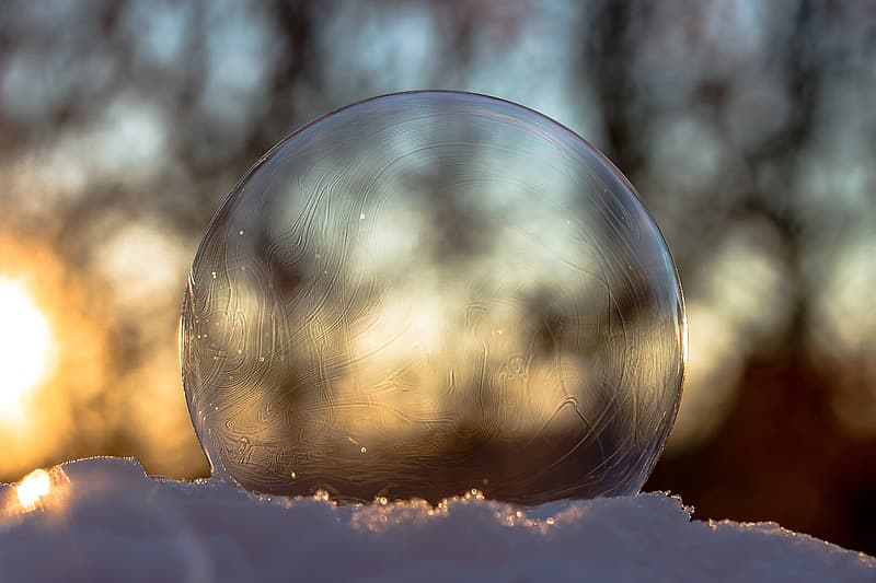 Round clear glass on white surface close-up photography