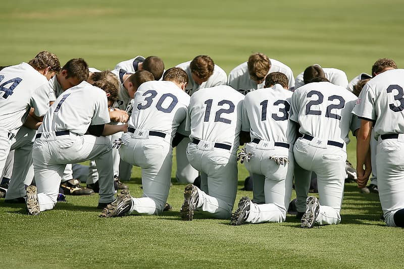 Baseball players gathered on field
