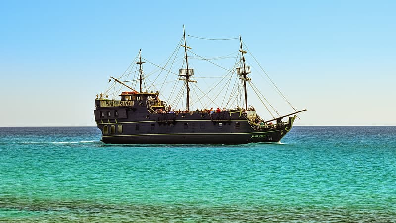 Brown pirate ship on body of water