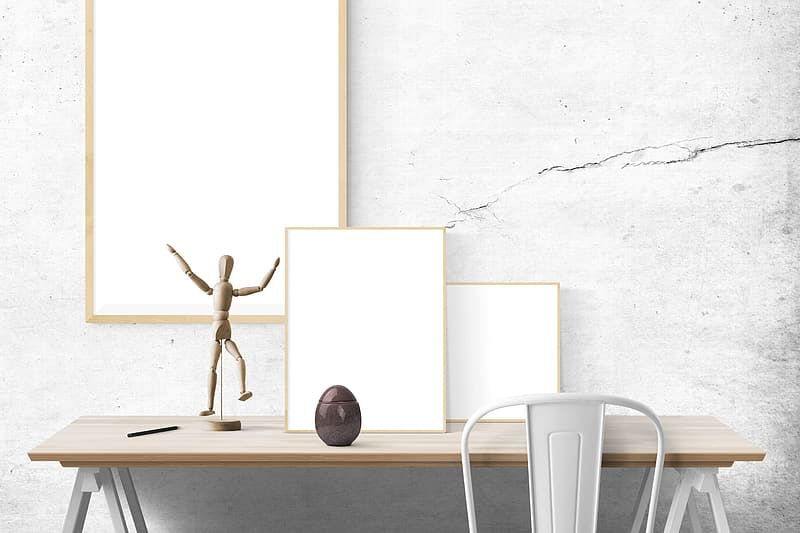 White framed and action figure on table
