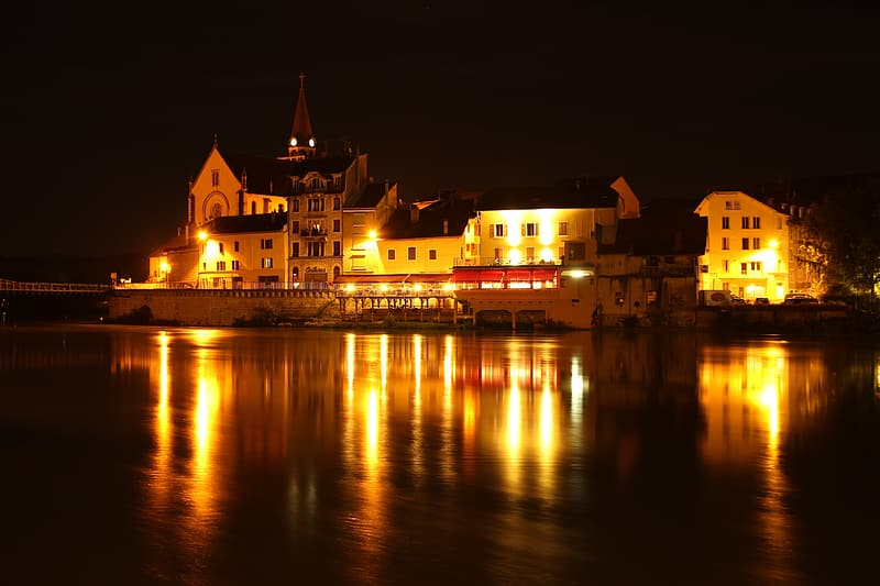 Building near body of water photograph during nighttime wallpaper
