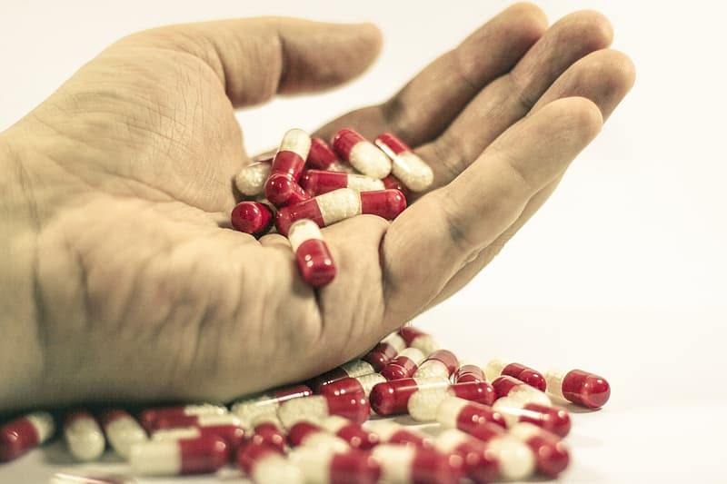 Red-and-white medicine pills