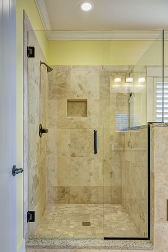 Closeup photo of clear glass shower stall