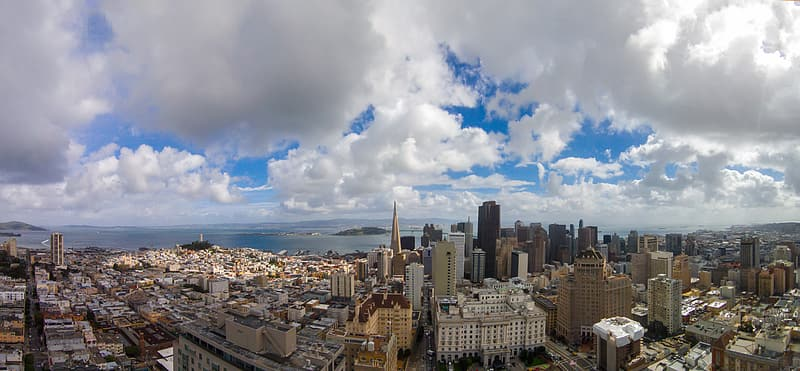 Aerial photography of city buildings under white clouds during daytime