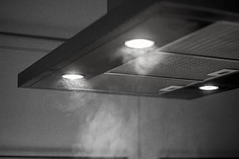 Close-up photo of range hood with turn-on lights