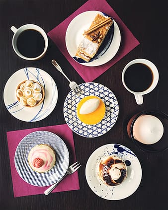 High angle photography of five pastries on top of plate beside two mugs