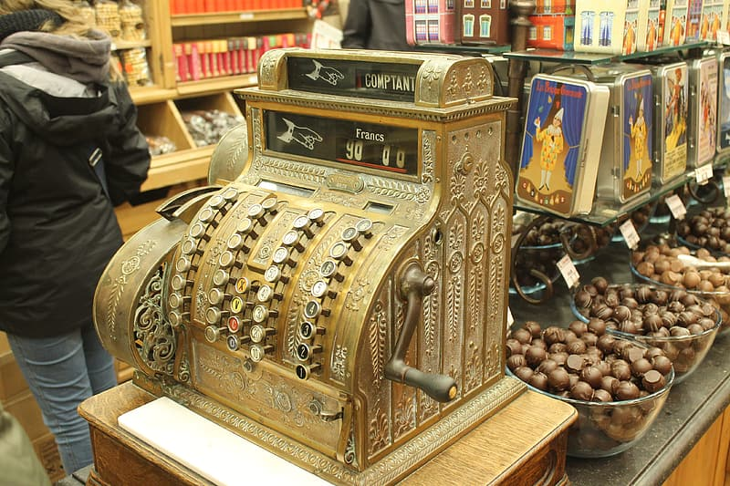 Brown and silver vintage cash register
