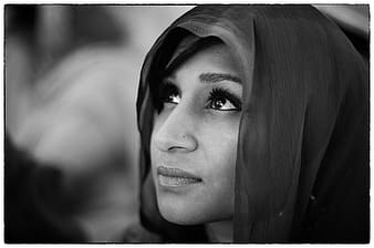 Grayscale photography of woman in headscarf