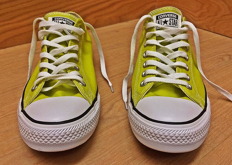 Pair of yellow-and-white Converse All-Star low-tops