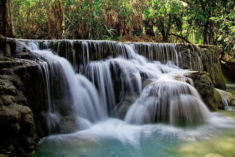 Time lapse photo of falls surrounded by plants