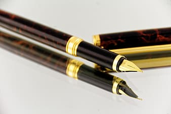 Brown and black fountain pens