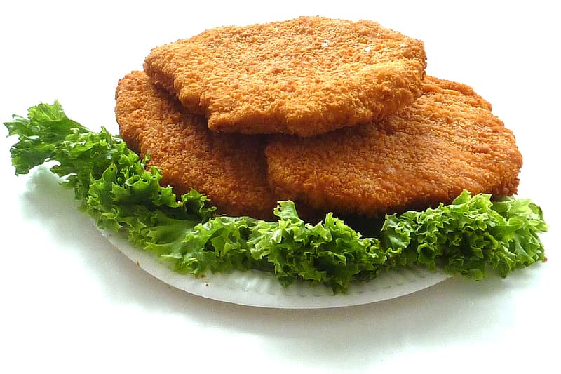 Deep fried dish with vegetables on round white plate