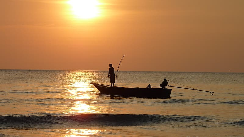 Silhouette of two person standing on boat