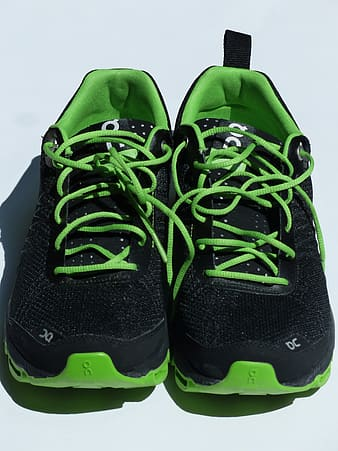 Black and green nike athletic shoes