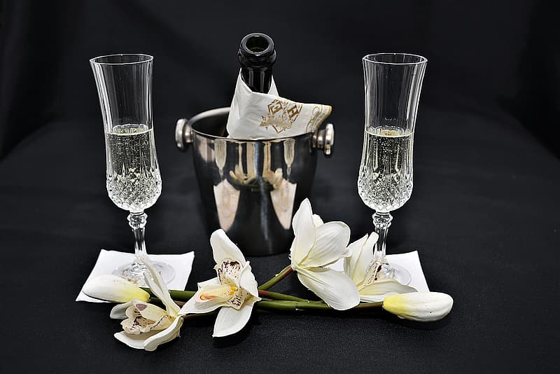 White flowers and clear wine glasses