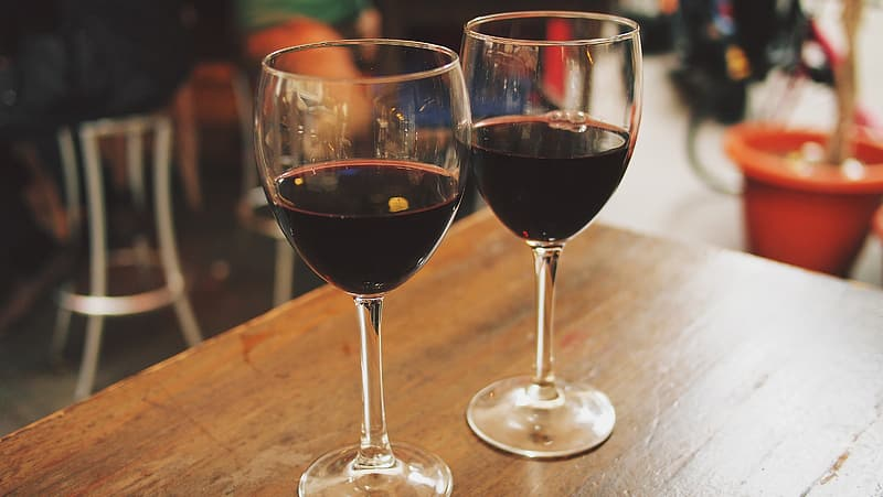 Photo of two wine glasses filled with liquor