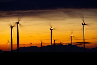 Silhouette of windmills