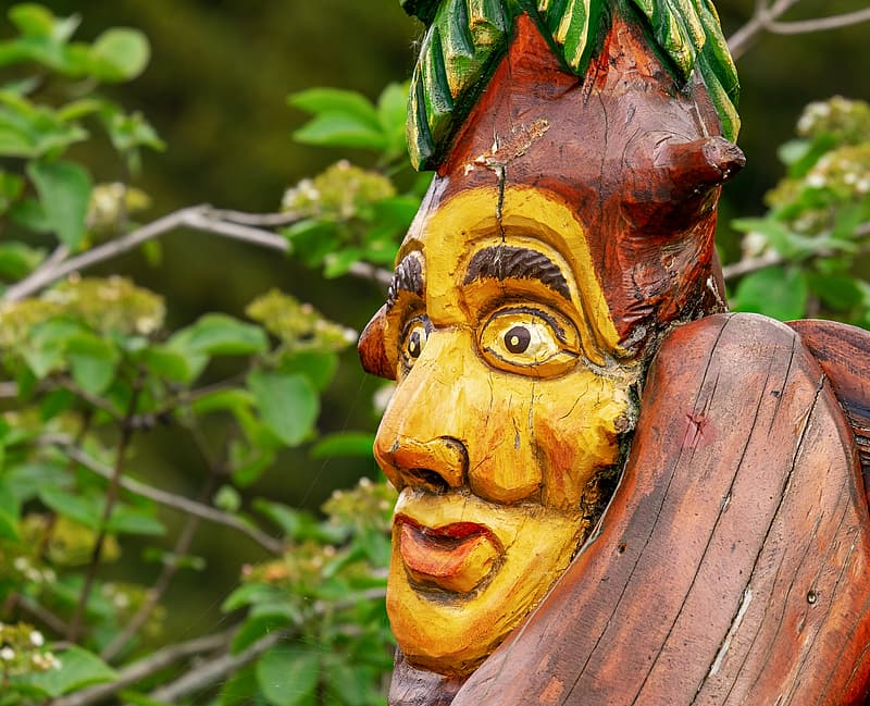 Close-up photography of yellow painted man decor