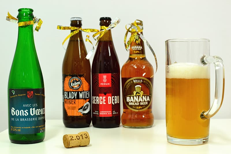 Beer mug beside four bottle