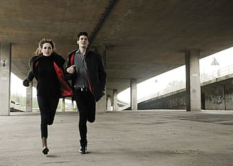 Two man and woman in running gesture
