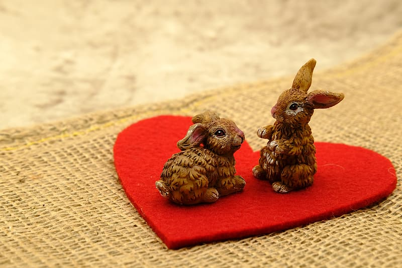 Two brown ceramic rabbit figurines