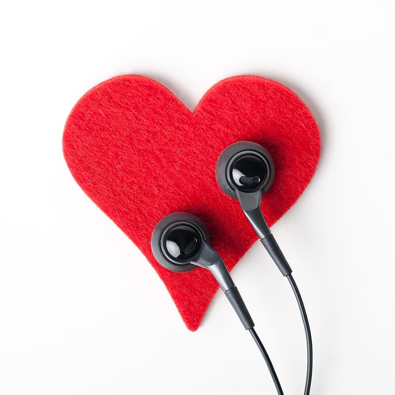 Black earphones on red heart decor