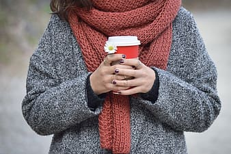 Women in gray sweater and red scarf