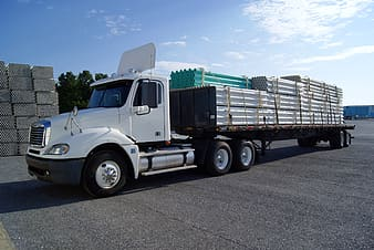 White Freight truck on gray concrete road