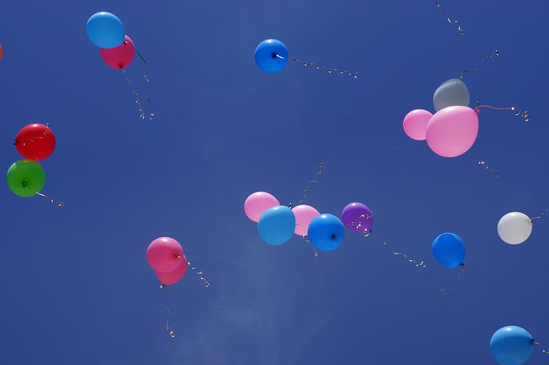 Assorted-color balloons at sky