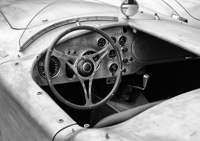 Grayscale photo of car steering wheel