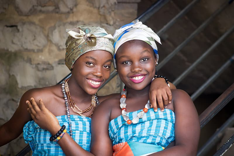 Two women wearing blue and white shirts