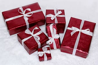 Red gift boxes with white laces