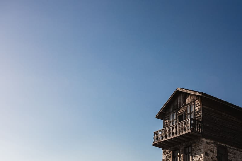 Brown wooden house under blue sky during daytime