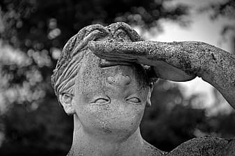 Grayscale photography of edited statue