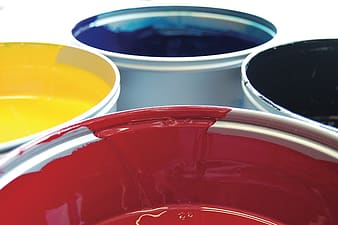 Four assorted-color paint buckets